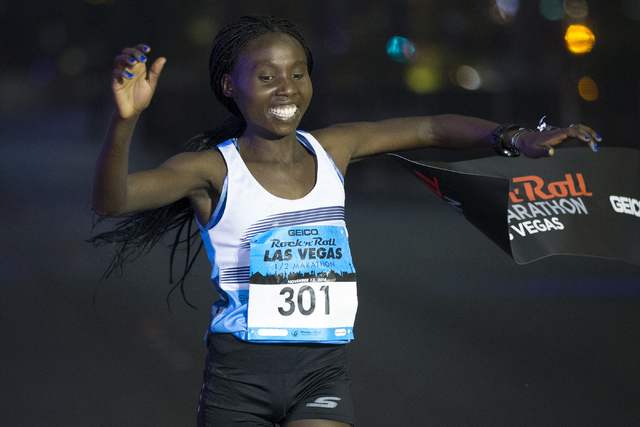 Elvin Kibet completes the half-marathon run in first place for women during the annual Rock 'n' Roll Marathon at the Strip near The Mirage hotel-casino on Sunday, Nov. 13, 2016, in L ...