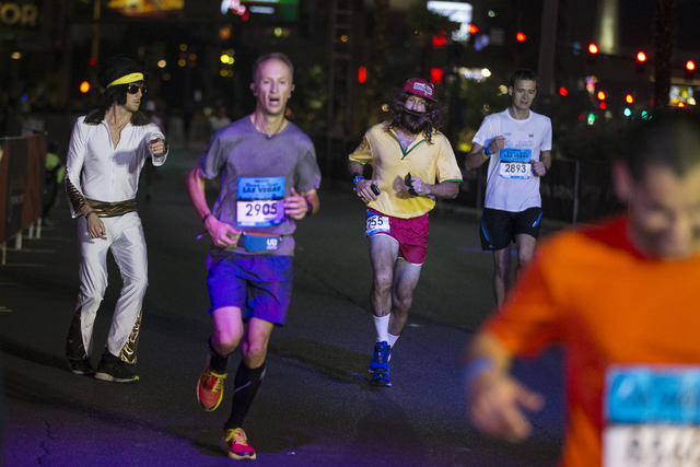 Runners complete the half-marathon race in the annual Rock 'n' Roll Marathon at the Strip near The Mirage hotel-casino on Sunday, Nov. 13, 2016, in Las Vegas. Erik Verduzco/Las Vegas ...