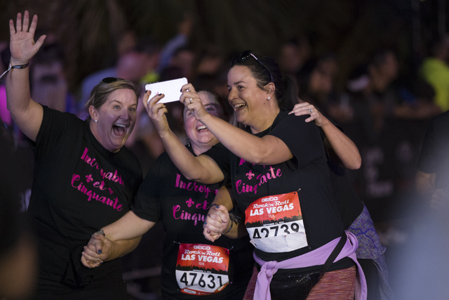Runners complete the 10K run in the annual Rock 'n' Roll Marathon at the Strip near The Mirage hotel-casino on Sunday, Nov. 13, 2016, in Las Vegas. Erik Verduzco/Las Vegas Review-Jou ...