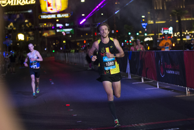 Eric Fitzpatrick, right, races for second place in front of Chip O'hara in the Rock-n-Roll Marathon at the Strip near The Mirage hotel-casino on Sunday, Nov. 13, 2016, in Las Vegas. Erik Verduzco/ ...