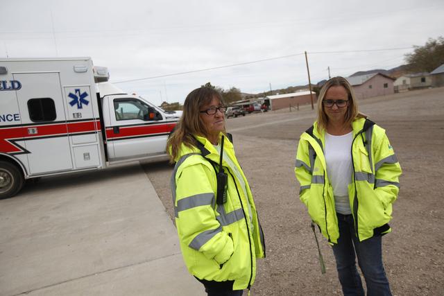 DeEtta Sligar and her daughter Danie Johnson stand near the ambulance on Monday, Oct. 3, 2016, in Tonopah, Nev. Rachel Aston/Las Vegas Review-Journal Follow @rookie__rae