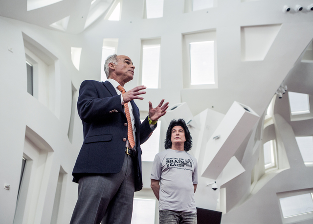 Dr. Charlie Bernick, associate medical director  for Cleveland Clinic Lou Ruvo Center for Brain Health, speaks during a news conference on Monday, Nov. 15, 2016. In the background is entertainer F ...