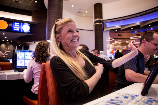 Kimberly Myers, a Station Casino employee, laughs during a bingo game in the newly refurbished bingo hall at Santa Fe Station hotel-casino, Friday, Nov. 18, 2016, in Las Vegas. Elizabeth Page Brum ...
