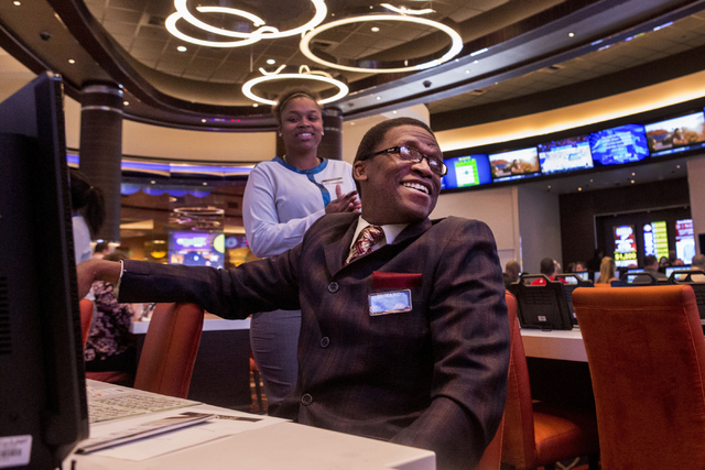 Edward Polk, a Station Casino employee, smiles after winning a game of bingo in the newly refurbished bingo hall at Santa Fe Station hotel-casino, Friday, Nov. 18, 2016, in Las Vegas. Elizabeth Pa ...