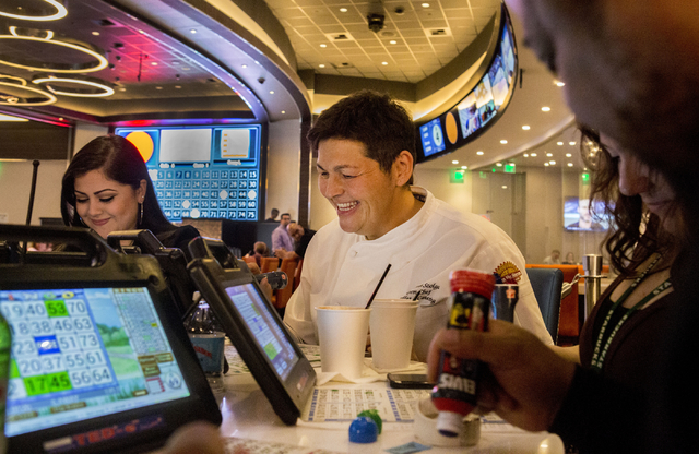 Santa Fe Station Chef Elizabeth Szolga, plays a game of bingo in the newly refurbished bingo hall at Santa Fe Station hotel-casino, Friday, Nov. 18, 2016, in Las Vegas. Elizabeth Page Brumley/Las  ...