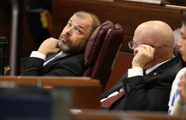 Nevada Assembly Republicans Paul Anderson, left, and Ira Hansen watch the final minutes of the session tick away at the Legislative Building in Carson City, Nev., on Monday, June 1, 2015. (Cathlee ...