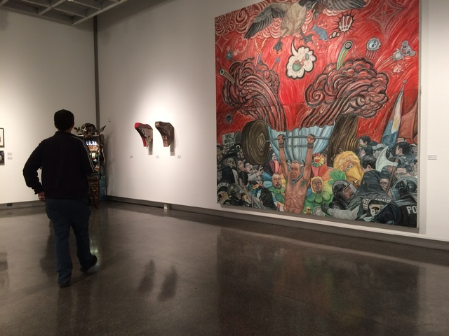 """An observer checks out the exhibit """"Skull"""" on opening night, Oct. 21, 2016, at The Studio inside Sahara West Library. The 41 artists in the show are almost all affiliated in some way with Neva ..."""