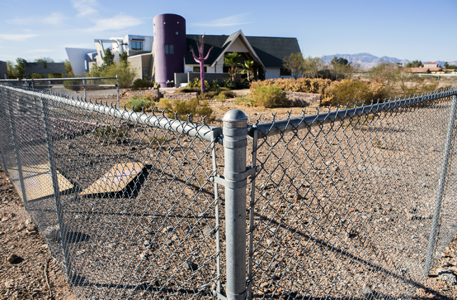 A secured fence surrounds The Slammer, the former home of magician Penn Jillette, in southwest Las Vegas, on Tuesday, Nov. 15, 2016. American West Homes bought the mansion and is schedule to demol ...
