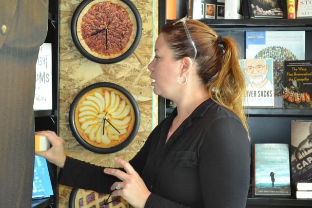 Gretchen Adams pulls a book off a shelf at The Writer's Block in downtown Las Vegas on Saturday, Nov. 26, 2016. Pashtana Usufzy/Las Vegas Review-Journal