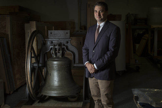 Peter Manseau poses for a portrait near a church bell made by Paul Revere at the Smithsonian National Museum of American History in Washington. Manseau was appointed as the first religion curator  ...