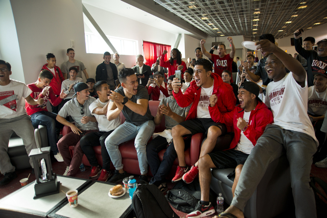 The UNLV men's soccer team reacts while watching the NCAA men's soccer tournament selection show on television inside the Mendenhall Center on the UNLV campus in Las Vegas on Monday, Nov. 14, 2016 ...
