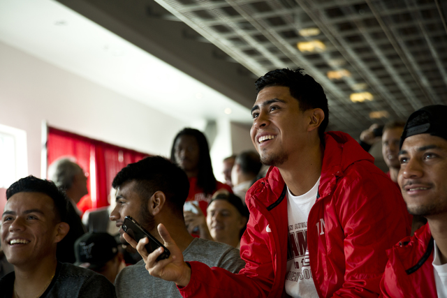 UNLV forward Memo Diaz, right, sits with his teammates while watching the NCAA men's soccer tournament selection show on television inside the Mendenhall Center on the UNLV campus in Las Vegas on  ...