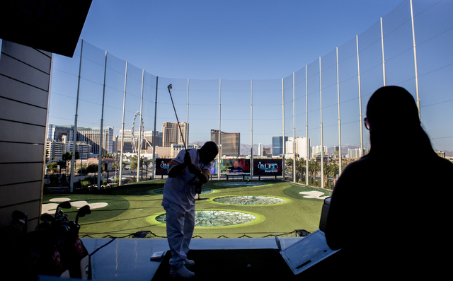 """A man swings a golf club during at Topgolf Las Vegas for the """"Soul Lunch & Greens,"""" a benefit for the Don Cornelius Foundation Friday, Nov. 4, 2016. Elizabeth Page Brumley/Las Vegas Review-Jou ..."""