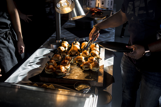 """Food created by Chef Huda is served at Topgolf Las Vegas for the """"Soul Lunch & Greens,"""" a benefit for the Don Cornelius Foundation Friday, Nov. 4, 2016. Elizabeth Page Brumley/Las Vegas Review ..."""