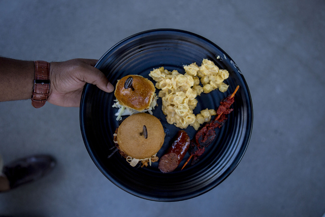 """A plate of soul food made by Chef Huda is held at Topgolf Las Vegas for the """"Soul Lunch & Greens,"""" a benefit for the Don Cornelius Foundation Friday, Nov. 4, 2016. Elizabeth Page Brumley/Las V ..."""