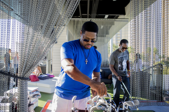 """Nathan Morris, member of the Boyz II Men rhythm-and-blues group, picks his club at Topgolf Las Vegas for the """"Soul Lunch & Greens,"""" a benefit for the Don Cornelius Foundation Friday, Nov. 4, 2 ..."""