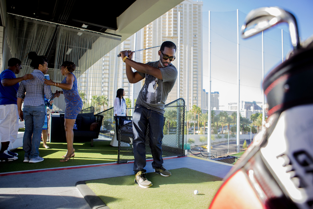 """Shawn Stockman, member of the Boyz II Men rhythm-and-blues group, swings a golf club at Topgolf Las Vegas for the """"Soul Lunch & Greens,"""" a benefit for the Don Cornelius Foundation Friday, Nov. ..."""