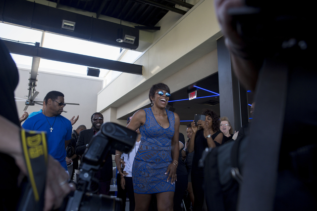 """Actress Dawnn Lewis, center, laughs at Topgolf Las Vegas for the """"Soul Lunch & Greens,"""" a benefit for the Don Cornelius Foundation Friday, Nov. 4, 2016. Elizabeth Page Brumley/Las Vegas Review ..."""