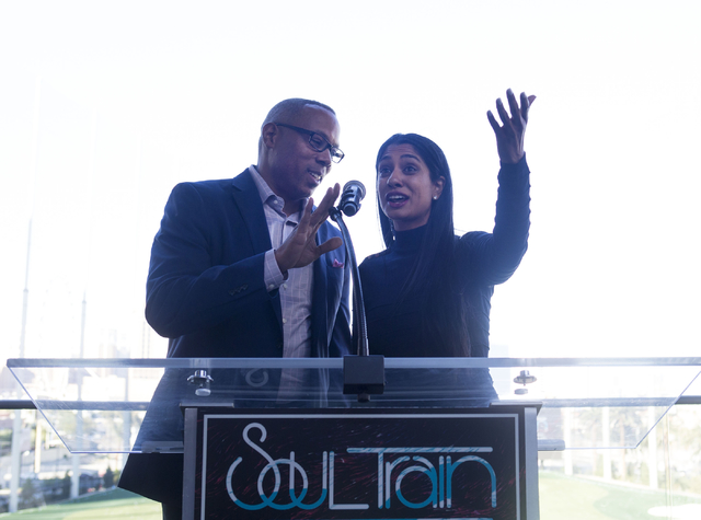 "ESPN host Jay Harris, left, and Seema Sadekar, professional golfer, speak at Topgolf Las Vegas for the ""Soul Lunch & Greens,"" a benefit for the Don Cornelius Foundation Friday, Nov. 4, 2016. E ..."