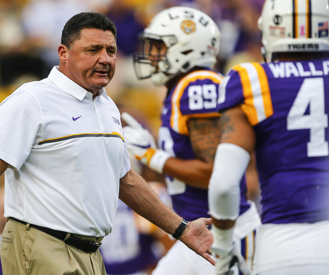 LSU head coach Ed Orgeron walks the field before an NCAA college football game against Southern Mississippi, Saturday, Oct. 15, 2016, in Baton Rouge, La. (AP Photo/Butch Dill)