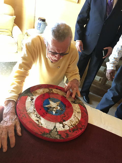Marvel Comics founder Stan Lee is shown signing a Captain America shield during an appearance at Treasure Island's Marvel Avengers S.T.A.T.I.O.N. on Friday, Nov. 18, 2016. (John Katsilometes/Las V ...