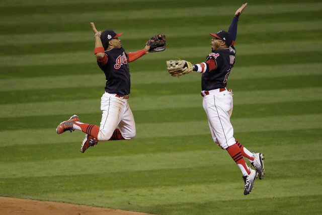 Cleveland Indians' Francisco Lindor and Rajai Davis celebrate after Game 1 of the World Series against the Chicago Cubs, Oct. 25, 2016, in Cleveland. The Indians won 6-0. (Gene J. Puskar/AP)