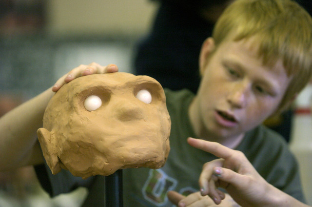 "Joshua Stokes, 11, works to recreate a face on a ""skull"" at Fernley Elementary School in Fernley, Nev., on April 5, 2006, using techniques similar to those used with the Spirit Cave Man. (Reno Gaz ..."