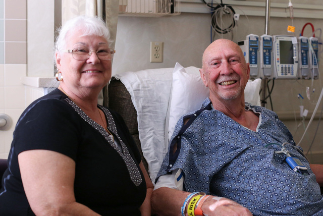 Gary Wilson, 79, right, poses for a photo with his wife Linda Wilson, 71, as he recovers from a heart surgery at Sunrise Hospital & Medical Center in Las Vegas on Thursday, Nov. 3, 2016. (Bret ...