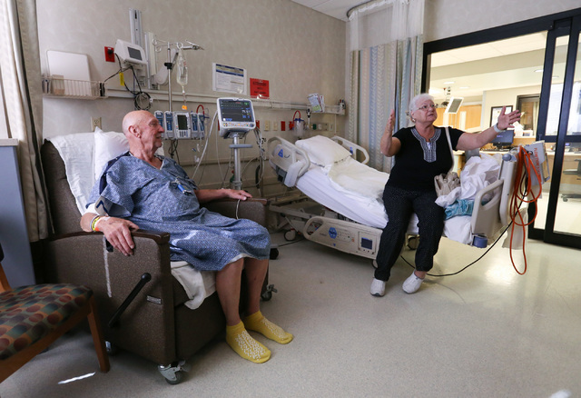 Gary Wilson, 79, left,  listens to his wife Linda Wilson, 71, while recovering from a heart surgery at Sunrise Hospital & Medical Center in Las Vegas on Thursday, Nov. 3, 2016. (Brett Le Blanc ...
