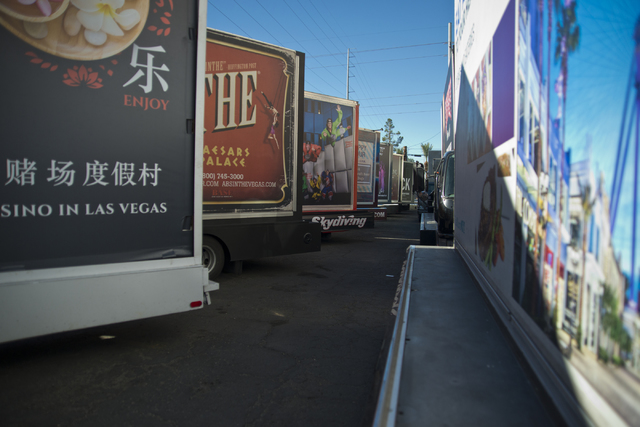 Mobile billboards are parked outside of Kre8 Media Outdoor Advertising located near the Palms hotel-casino in Las Vegas on Friday, Nov. 18, 2016. Daniel Clark/Las Vegas Review-Journal Follow @DanJ ...