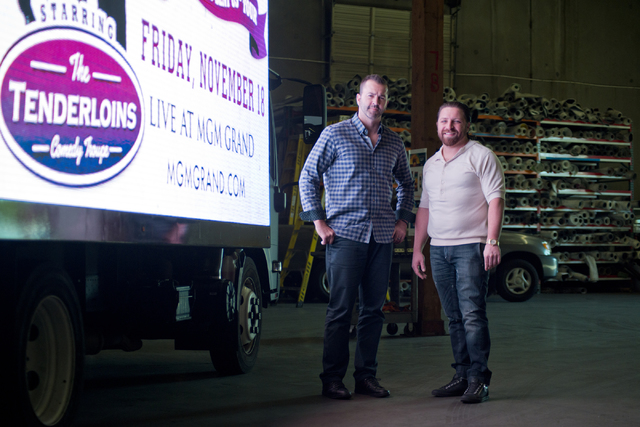 Managing partners of Kre8 Media Outdoor Advertising Shaun Habibian, right, and Jeremie Watkins with one of their mobile digital billboards inside their shop near the Palms hotel-casino on Friday,  ...