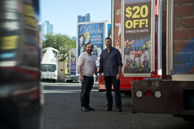 Managing partners of Kre8 Media Outdoor Advertising Shaun Habibian, left, and Jeremie Watkins with some of their mobile billboards outside their headquarters near the Palms hotel-casino on Friday, ...