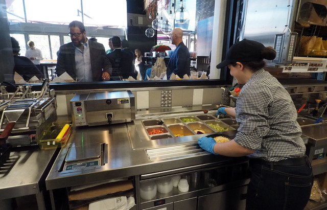 Taco Bell Manager Lyndsey Quinn Prepares Food In The Open Kitchen At The  New Taco Bell