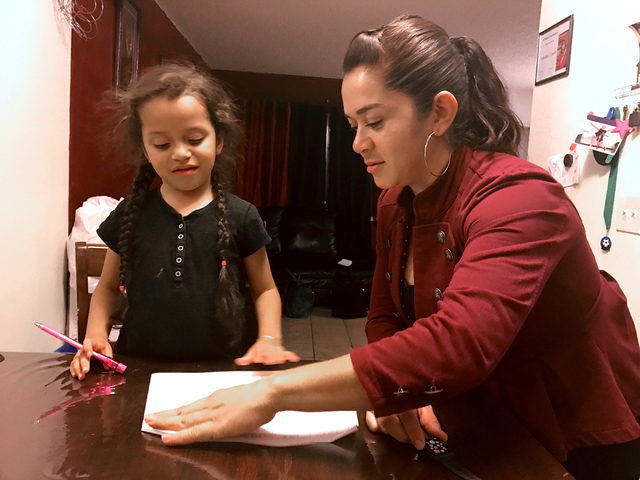 Dalia Jimenez, right, reviews homework with her 6-year-old daughter Esmeralda Irianda-Jimenez in their home in downtown Las Vegas on Wednesday, Nov. 16, 2016. Amelia Pak-Harvey/Las Vegas Review-Jo ...