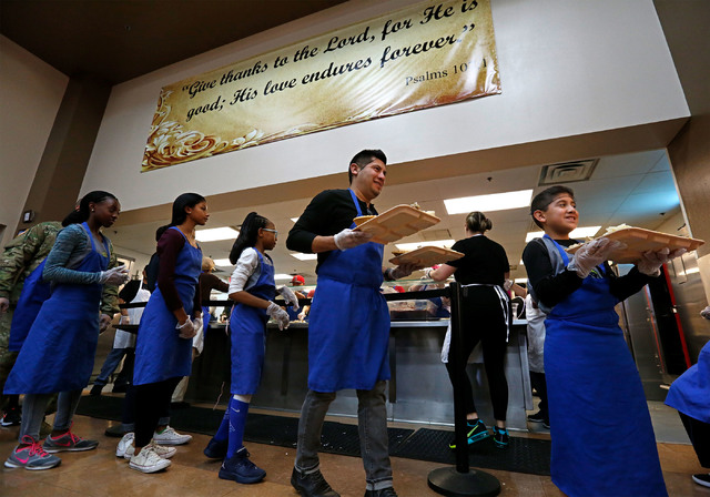 Volunteers help serve turkey dinners to the guests at the Las Vegas Rescue Mission in Las Vegas, Wednesday, Nov. 23, 2016. Chitose Suzuki/Las Vegas Review-Journal