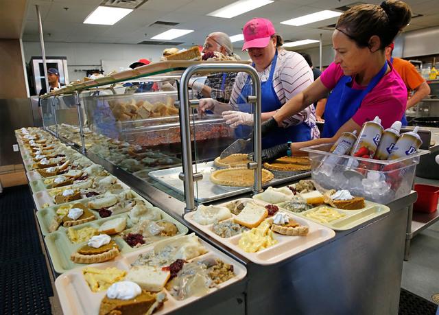 Volunteers serves turkey dinners at the Las Vegas Rescue Mission in Las Vegas, Wednesday, Nov. 23, 2016. Chitose Suzuki/Las Vegas Review-Journal