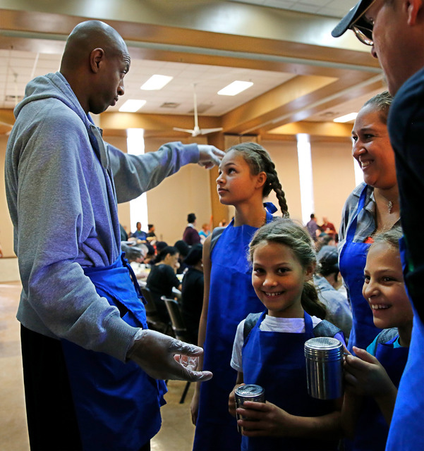 Jerome Williams, former New York Knicks player and Vegas Ballers Basketball Club coach, from left, talks with his players Jayla Meeks, 12, her sisters Ava, 8, and Leah, 8, of Henderson, while they ...