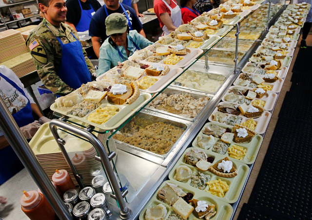 Volunteers serves turkey dinners at the Las Vegas Rescue Mission in Las Vegas, Wednesday, Nov. 23, 2016. Chitose Suzuki/Las Vegas Review-Journal
