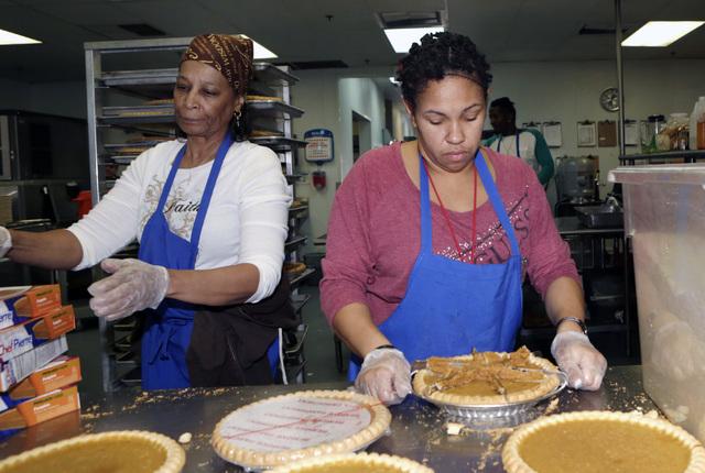 Edna Sanders, left, and Yolanda Pace, volunteers at Las Vegas Rescue Mission, cut pumpkin pies, Wednesday, Nov. 23, 2016. Bizuayehu Tesfaye/Las Vegas Review-Journal Follow @bizutesfaye