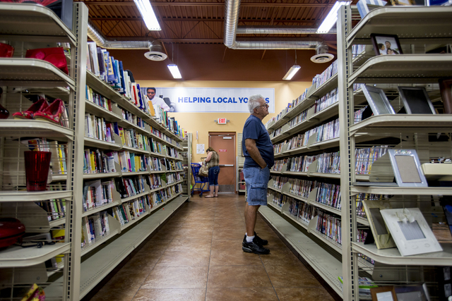Goodwill costumer Bob Wagner looks at the movie selection at the Goodwill Centennial Retail Store, Friday, Sept. 30, 2016, in Las Vegas. Elizabeth Page Brumley/Las Vegas Review-Journal Follow @ELI ...