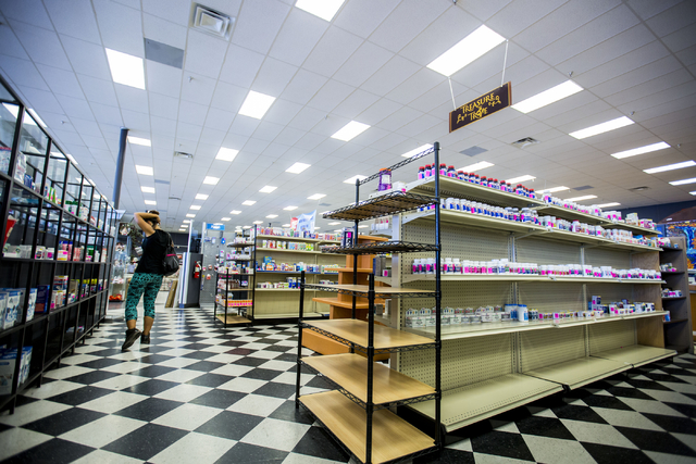 An Opportunity Village Thrift Shop customer shops in the medicine isle in the shop at Decatur Meadows Center, Friday, Sept. 30, 2016, in Las Vegas. Elizabeth Page Brumley/Las Vegas Review-Journal  ...