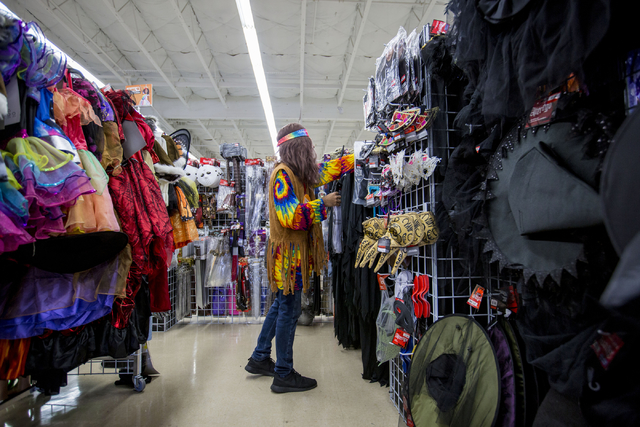 Kidanny Gonzalez, Savers costume consultant, sorts costumes at the store, Friday, Sept. 30, 2016, in Las Vegas. Elizabeth Page Brumley/Las Vegas Review-Journal Follow @ELIPAGEPHOTO