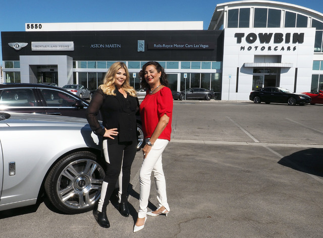 Jesika Towbin-Mansour, left, and her mother, Carolynn Towbin, pose next to a Rolls-Royce at Towbin Motorcars on Sahara Avenue in Las Vegas, Tuesday, Oct. 18, 2016.  (Jerry Henkel/Las Vegas Review- ...