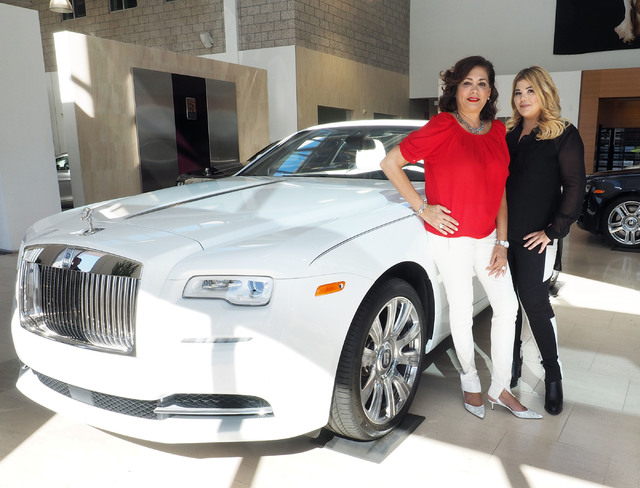 Jesika Towbin-Mansour and her mother Carolynn Towbin pose next to a Rolls-Royce at Towbin Motorcars on Sahara Avenue in Las Vegas, Tuesday, Oct. 18, 2016. (Jerry Henkel/Las Vegas Review-Journal)