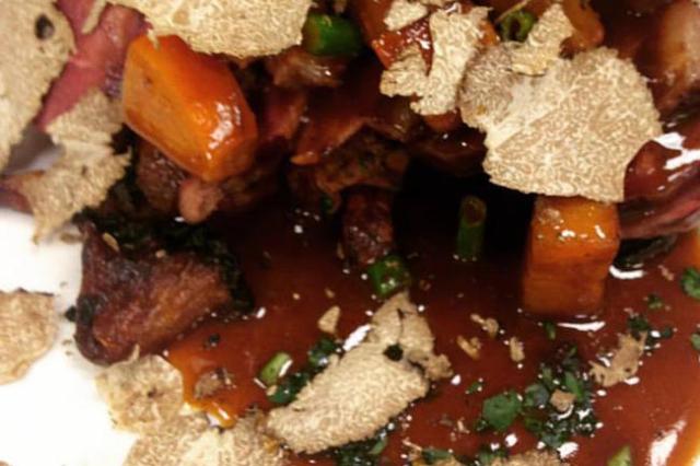 Seared duck breast, persimmon foie gras reduction, wild mushrooms and fresh black truffles. (Delmonico Steakhouse/Facebook)