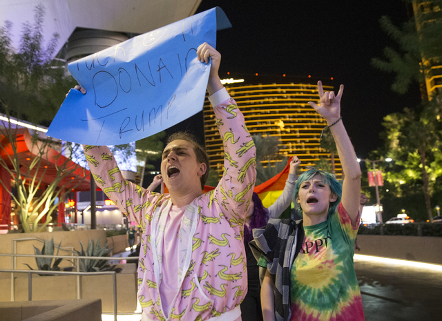 "Anti-Trump protesters Alexander Kostas, left, and Kid Crawford lead a chant of ""Not my president"" on the Strip on Weds, Nov. 9, 2016, in Las Vegas. Benjamin Hager/Las Vegas Revie ..."