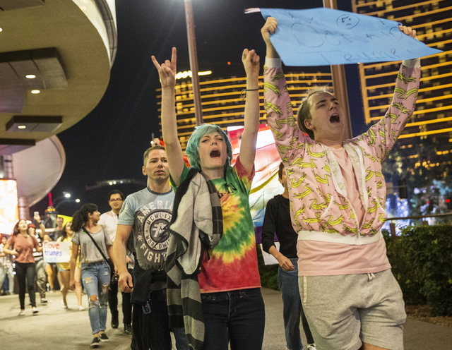 "Anti-Trump protesters Alexander Kostas, right, and Kid Crawford lead a chant of ""Not my president"" on the Strip on Weds, Nov. 9, 2016, in Las Vegas. Benjamin Hager/Las Vegas Revi ..."