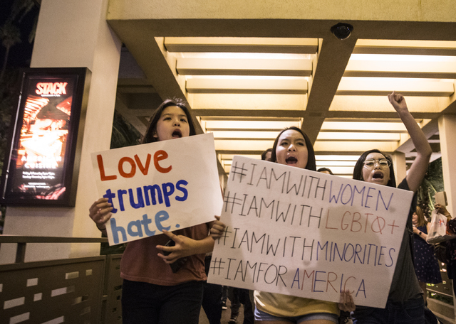 "Anti-Trump protesters Jeannie Mai, left, Julie Danh and Kelsey Nguyen march on the Strip chanting ""Not my president"" on Weds, Nov. 9, 2016, in Las Vegas. Benjamin Hager/Las Vegas ..."