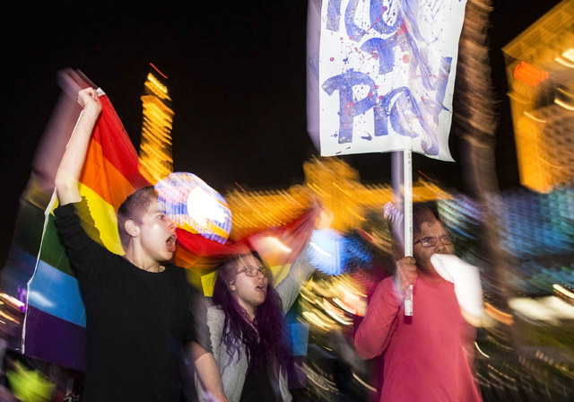 "Anti-Trump protester Pino Alessi, left, marches on the Strip chanting ""Not my president"" on Weds, Nov. 9, 2016, in Las Vegas. Benjamin Hager/Las Vegas Review-Journal"