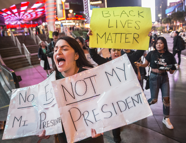 "Nataly Ramos marches with a crowd of anti-Trump protesters chanting ""Not my president"" on Las Vegas Boulevard on Weds, Nov. 9, 2016, in Las Vegas. Benjamin Hager/Las Vegas Review ..."